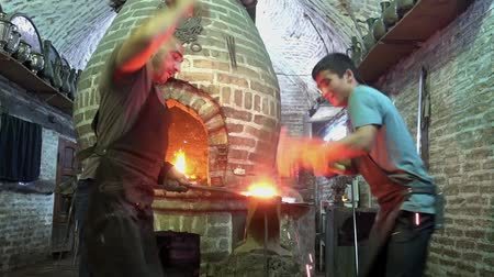 demirci : Bukhara, Uzbek - 20170522 - Sparks fly as blacksmiths pound hot metal