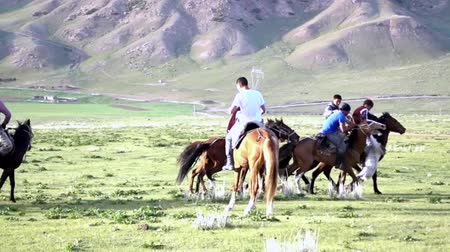 kul : Issyk Kul, Kyrgyzstan - 20170529 - Buzkashi players skirmish from goal with goat carcass Stock Footage