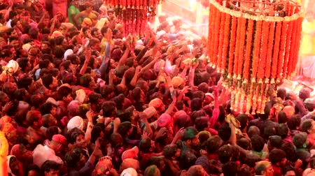 color surge : Barsana, India - 20180223 - Holi Festival  -  People In Crowd Have No Choice But To Go With Surge Stock Footage