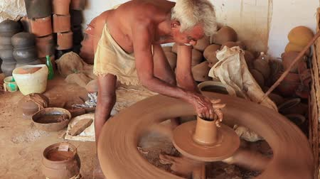 primeval : Madurai, India - 20180310 - Man Uses Fully Manual Potter Wheel  -  Starts Pot From Prior Base