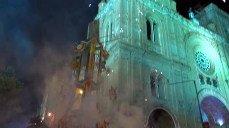 common : Cuenca, Ecuador  -  20180602  -  Fireworks Castle  -  Slow Motion  -  Rockets Fire Out of Canisters With Pan Up To Fireworks