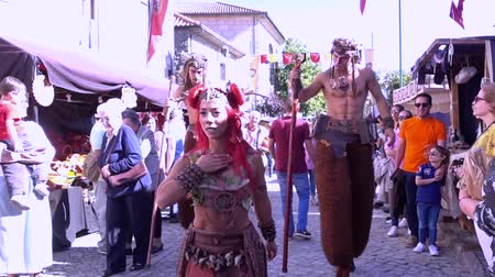 フォロー : Penedono, Portugal - 20170701 - Medieval Fair  -  Satyrs Follow Nymph 動画素材