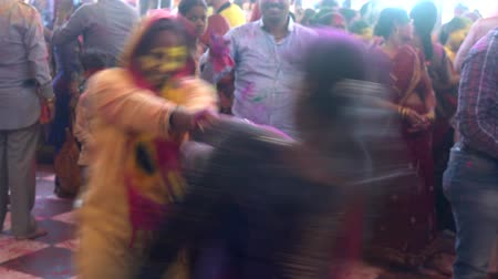 color surge : Barsana, India - 201802242 -  Holi Festival  -  Dancing  -  Two Women Spin Each Other Stock Footage
