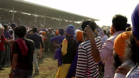 konie : Anandpur Sahib, India - 20180302 -  Hola Mohalla  -  Sikh Festival  -  Audience Closes Horse Race Path Wideo