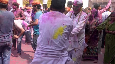 color surge : Barsana, India - 201802242 -  Holi Festival  -  Chaos  -  Two Men In White Spin Each Other