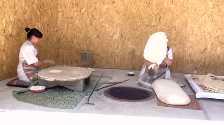 lavash : Yerevan, Armenia - 20170614 - Two women make lavash in traditional manner