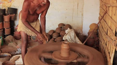 kamenina : Madurai, India - 20180310 - Man Uses Fully Manual Potter Wheel  -  Cuts Off Pot
