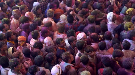 color surge : Barsana, India - 201802242 -  Holi Festival  -  Chaos  -  Crowd Below Surges But Nowhere To Go