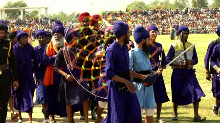 lő : Anandpur Sahib, India - 20180302 -  Hola Mohalla  -  Sikh Festival  -  Men Walk With Chakari