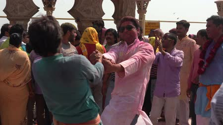 color surge : Barsana, India - 201802242 -  Holi Festival  -  Dancing  -  Two Men Spin Each Other Stock Footage