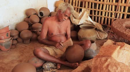 kamenina : Madurai, India - 20180310 - Man Uses Fully Manual Potter Wheel  -  Finished Pots With Wooden Hammer
