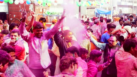 color surge : Barsana, India - 201802242 -  Holi Festival  -  Paint Is Thrown As Frantic Crowds Dance Stock Footage