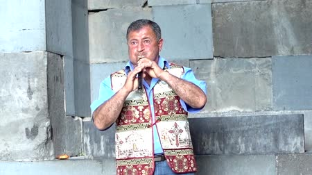 traditional instruments : Yerevan, Armenia  -  20170614  -  Man Plays Traditional Duduk Wind Instrument Haunting Melody Finishes Stock Footage