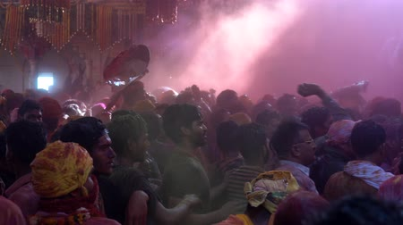 color surge : Barsana, India - 201802242 -  Holi Festival  -  Chaos  -  Eye Level View of Surging Crowd Stock Footage