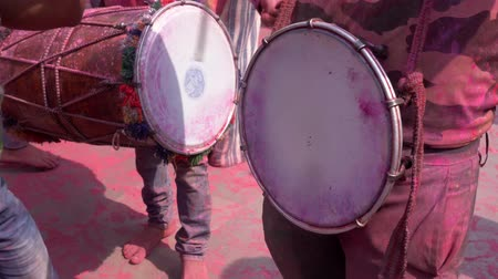color surge : Barsana, India - 201802242 -  Holi Festival  -  Chaos  -  Drummers Keep The Beat Stock Footage