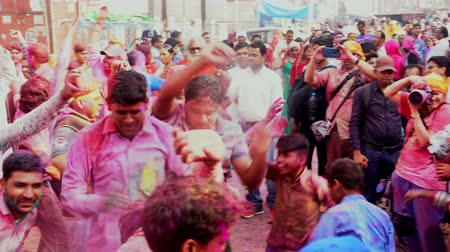color surge : Barsana, India - 201802242 -  Holi Festival  -  Frantic Crowds Dance As Paint Is Thrown Stock Footage