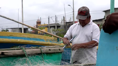 industrial fishing : San Pedro, Ecuador - 20180915 -  Closeup of Man Rethreading Net