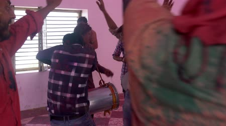 color surge : Barsana, India - 201802242 -  Holi Festival  -  Chaos  -  Men Jump Around The Drummer
