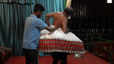acteur : Munnar, India - 20180311 -  Prep For Traditional Theater - Actor Starts Putting On Hoop Dress