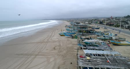 zaparkoval : San Pedro, Ecuador - 20180915 - Drone Aerial  -  Flight Along Beachfront and Parked Fishing Boats