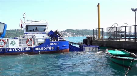 collected : Istanbul, Turkey - May 30, 2016 - Garbage Collecting Boat on Bosphorus Strait Profile Stock Footage