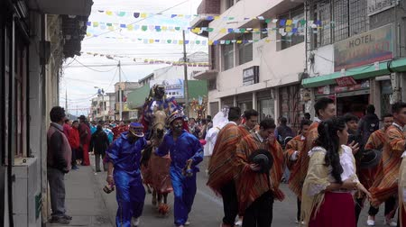 patron : Latacunga, Ecuador  -  20180925  -  Mama Negra In Blue Rides Past On Horse In Parade