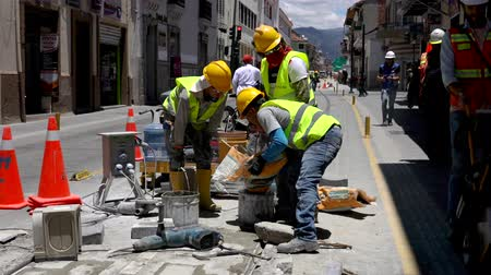 sıva : Cuenca, Ecuador  -  20180920  -  Worker Pours Grout Into Bucket To Mix Stok Video