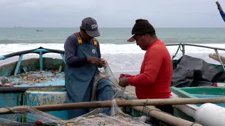 industrial fishing : San Pedro, Ecuador - 20180915 -  Two Men Fix Two Nets