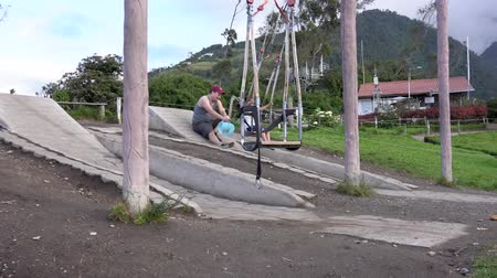 alpes : Banos, Ecuador - 20180924 - Girl Laughs When Pushed By Father on Casa de Arbol Child Swing