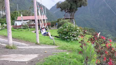 pushed : Banos, Ecuador - 20180924 - Girl Is Pushed By Father on Casa de Arbol Child Swing