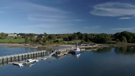 docked : Chebeague Island, Maine  -  20181006  -  Aerial Drone  -  Fly Towards and Down To Ferry At Dock Stock Footage