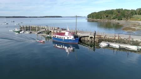 docked : Chebeague Island, Maine  -  20181006  -  Aerial Drone  -  Skiff Pulls In Front Of Ferry At Dock