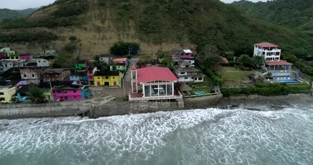 barışçı : La Entrada, Ecuador - 20180914 - Drone Aerial  -  Distant Pan of Village Showing Newly Painted Homes and High Tide