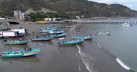 megtöltött : Puerto Lopez, Ecuador - 20180913 - Drone Aerial  -  Flying Along Coast Filled With Boats and People Towards Pier