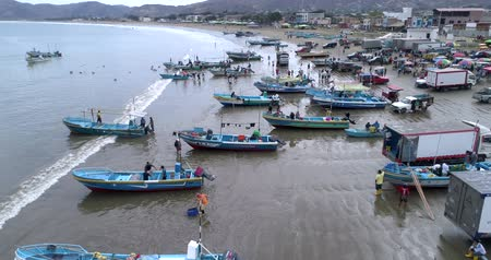 small vessels : Puerto Lopez, Ecuador - 20180913 - Drone Aerial  -  Flying Along Coast Filled With Boats and People