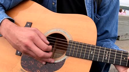 strings : Chebeague Island, Maine  -  20181007  -  Closeup of Hand Strumming Acoustic Guitar Stock Footage