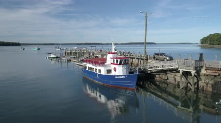 docking : Chebeague Island, Maine  -  20181005  -  Aerial  -  Drone Flies Towards And Up Over Chebeague Island Ferry Stock Footage