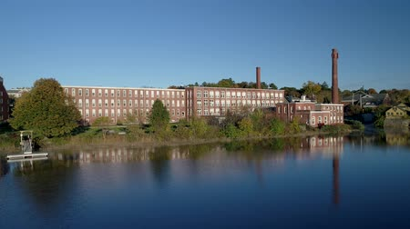 rost : Aerial Drone  -  Fly Over Mirror Smooth River Towards Old Textile Factory in Exeter, New Hampshire 4K