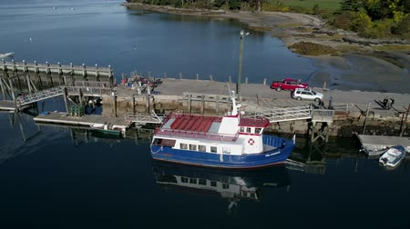 docked : Chebeague Island, Maine  -  20181005  -  Aerial Drone  -  One Quarter Orbit Starboard Towards Bow Of Chebeague Island Ferry Stock Footage