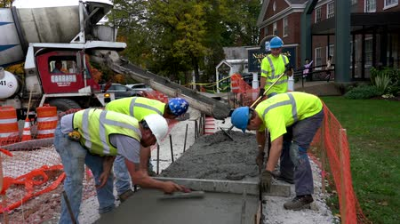 public worker : Middlebury, Vermont  -  20181010  -  Construction Crew Smooths Concrete In Newly Poured Cement Sidewalk
