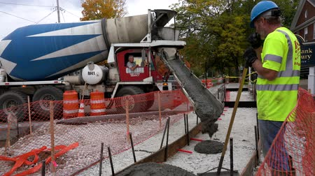 public worker : Middlebury, Vermont  -  20181010  -  Cement Truck Dumps Concrete For New Sidewalk Construction As Crew Levels