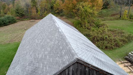 barnyard : Aerial Drone  -  Fly Over Old Barn Towards Vibrant Colored Trees in Fall in Vermont 4K