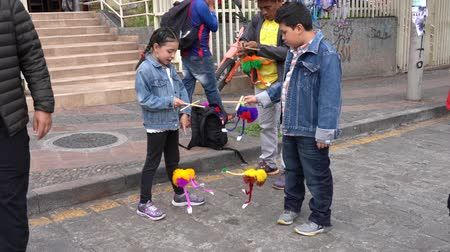 долл : Cuenca, Ecuador - 20181003 - Cuenca Independence Day Festival  -  a Boy and Girl Play With Their New Monster String Puppets