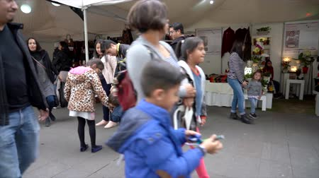adil : Cuenca, Ecuador - 20181003 - Cuenca Independence Day Festival TimeLapse  -  Fast Pan Across Outdoor Row of Vendor Tents Filled with Customers Stok Video