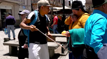 silkworm : Cuenca, Ecuador  -  20180920  -  Street Vendor Tries To Sell Chontacuro To Indigenous Woman2