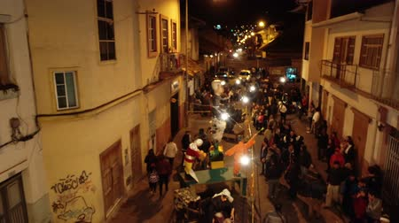 костер : Cuenca, Ecuador - December 31, 2018 - Drone flies over street showing people admiring installation art on New Years Eve