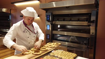 isztambul : Istanbul, Turkey-2019-05-04- Making Simit Turkish Bagel step 2 putting in oven.