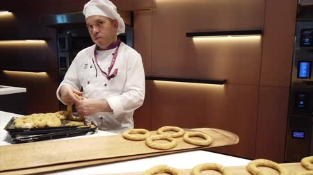 trouba : Istanbul, Turkey-2019-05-04- Making Simit Turkish Bagel step 1 rolling out dough.