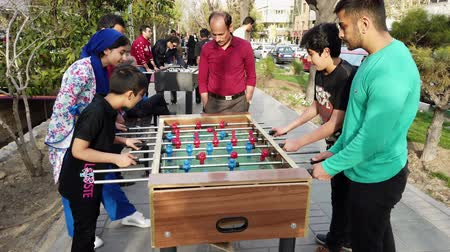 futball labda : Tehran, Iran - 2019-04-03 - Street Fair Entertainment 17 - Foosball 3 - Children.