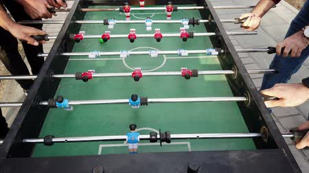 futball labda : Tehran, Iran - 2019-04-03 - Street Fair Entertainment 18 - Foosball 4 - Closeup.
